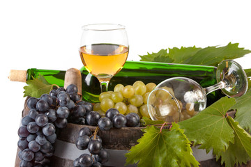 Bottle of white wine and various autumn fruits