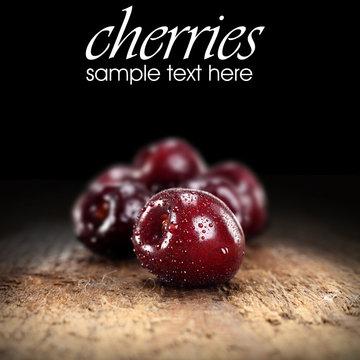 cherries on black background