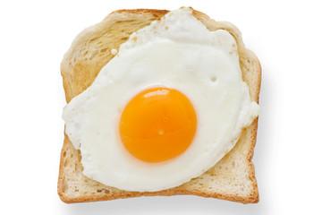 Foto op Canvas Gebakken Eieren Fried egg on white toast from above.