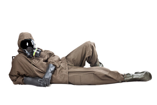 Man in Hazard Suit layng on the ground