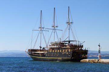 Antique ship on the Aegean sea in Greece