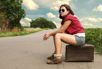 Young girl traveler on the lonely road