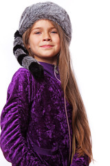 Portrait of beautiful girl posing on white background in fur hat