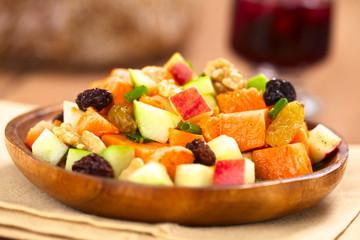 Salad made of sweet potato, apple, nut, raisin, shallot