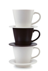 Three plates and coffee cups stacked together