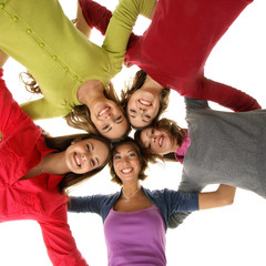 A group of young and attractive teenage girls holding together