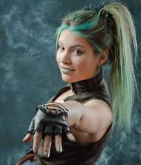 Beautiful portrait of the smiling steampunk girl with green hair