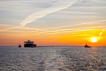Seascape - Tanker ship at sunrise.