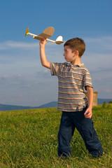 Fototapeta Boy playing with model airplane © Krzysztof Nogawczyk