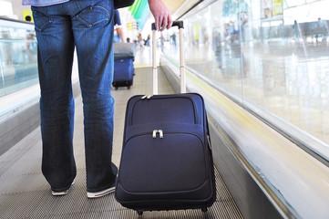 Traveler with a bag on the speedwalk