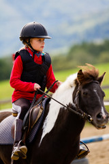 Horse riding -  lovely equestrian is riding on a horse