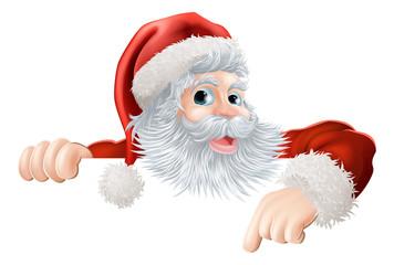 Christmas Santa pointing down at sign