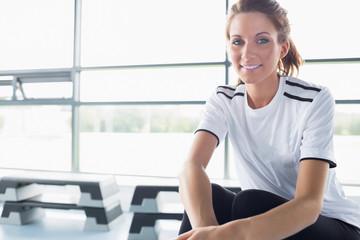 Woman sitting on row machine