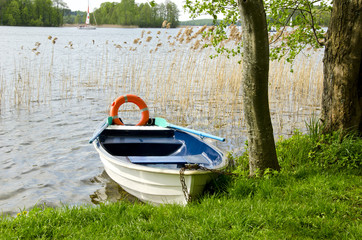 one boat on lake with life buoy