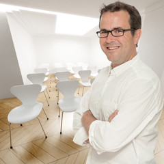 Smiling man in conference room