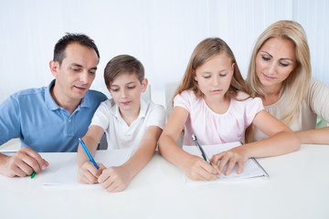 Parents Helping Their Children With Their Homework