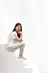 a young asian woman relaxing