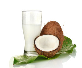 glass of coconut milk and coconuts isolated on white