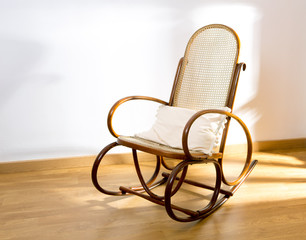 Golden retro rocker wooden swing chair on wood floor