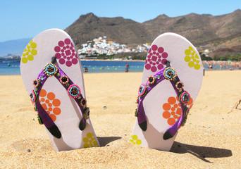Flip-flops in the sand of Teresitas beach. Tenerife island, Cana