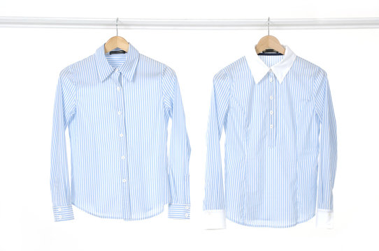 Pair woman shirt on a hanger studio isolated