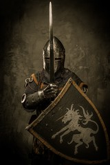 Foto op Canvas Ridders Medieval knight on grey background