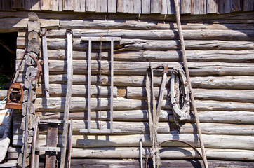 ancient wooden etnographic barn wall with tools