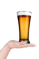 Glass of beer on man's hand