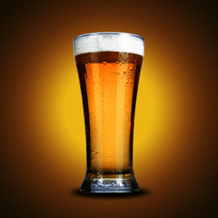 glass of beer on yellow background