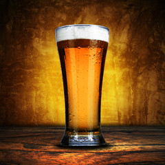 Glass of beer on grunge background