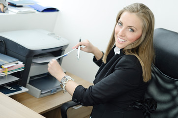 Pretty blondy smiling and printing