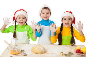 Three kids with Christmas cooking