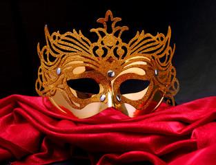 Paper mask on a red velvet.