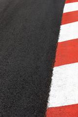Motor race asphalt curb on Monaco Grand Prix street circuit