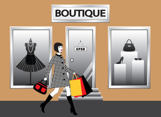women with shopping bags walking in front of  boutique showcase