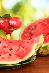 Refreshing desserts of watermelon on green background close-up