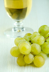 Fresh grapes and glass of white wine