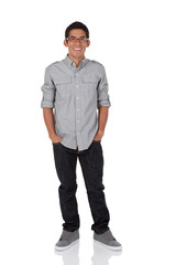 College age man standing with hands in pocket