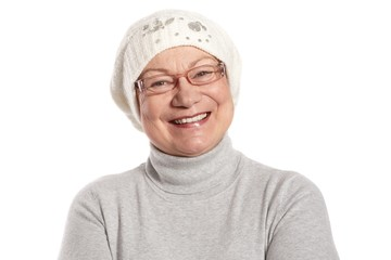 Portrait of happy elderly lady in cap