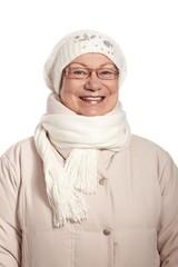 Winter portrait of elderly lady smiling