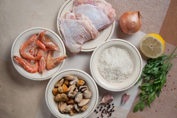 Ingredients for Paella ready meal with shrimp, chicken
