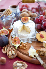 Cheese, bread and autumn fruit