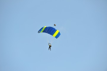 parachutist with red parachute in the sky