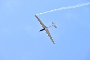 glider aerobatics with smoke