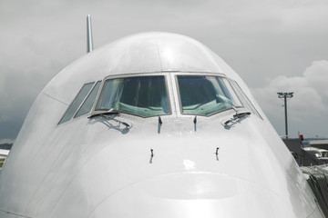 detail of aircraft nose with cockpit window