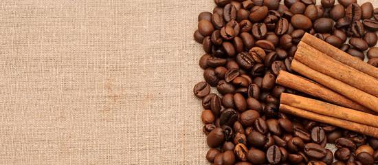 handful aromatic coffee beans with cinnamon