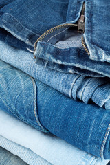 Stack of jeans in different colors