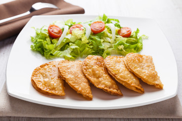 Tuna patties with lettuce salad in a plate
