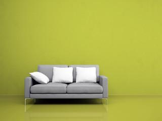Modern grey sofa on the green wall