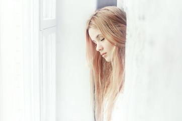beautiful girl dreams of the window